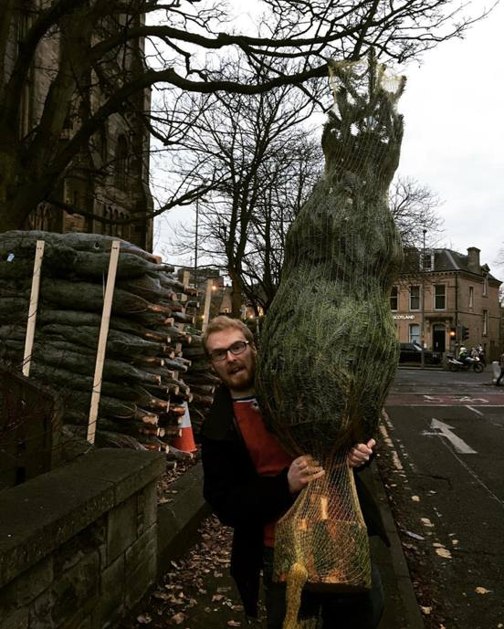 Me carrying the Christmas tree home