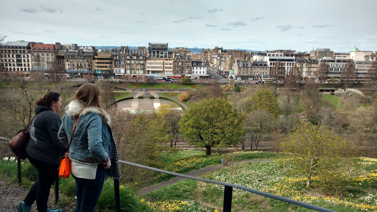 Friends looking out over Princes Street Gardens