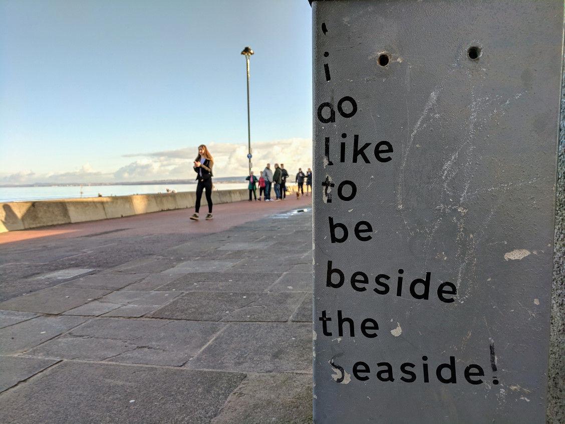 """I do like to be beside the seaside"" written on the wall in Portobello"