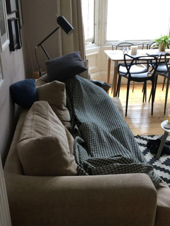 Me lying hungover on the sofa