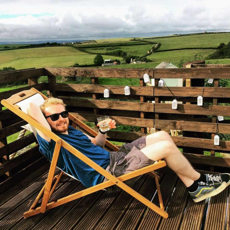 Me smugly sitting in a deckchair at Treyhill Farm