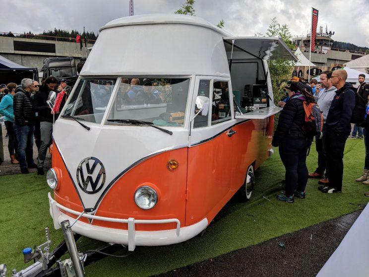 Ordering a coffee from a vintage orange campervan