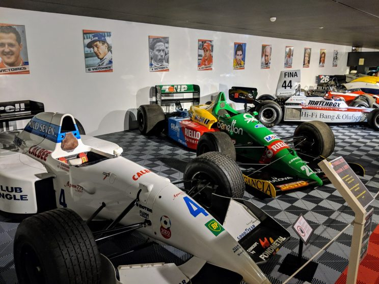 Cars on display in the museum, including a Tyrrell and a Benetton