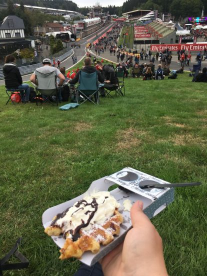 Alex eating her waffle on Eau Rouge