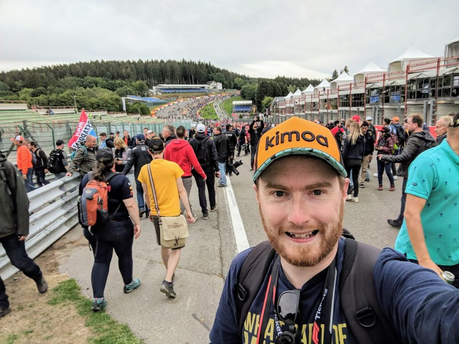 Me taking a selfie with crowds on Eau Rouge