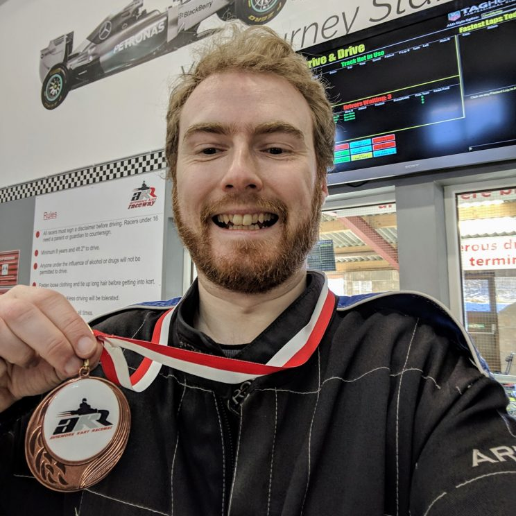Me posing with my bronze medal for karting
