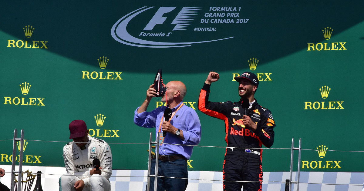 Patrick Stewart does the shoey with Daniel Ricciardo