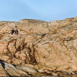 People sitting on rocks at Marstrand