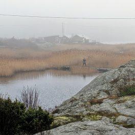 Person walking across a bridge at Marstrand